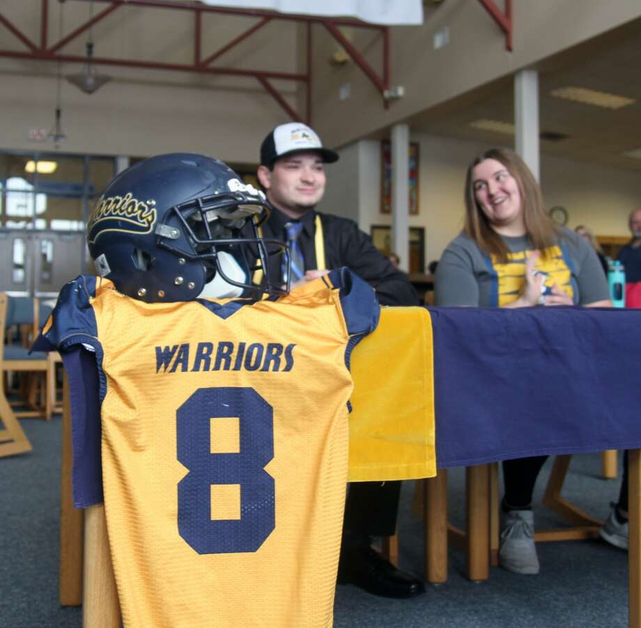A pair of North Huron Warriors, Chris Augle and Patricia Pineau, signed their Letters of Intent to play collegiate athletics on Wednesday, Feb. 26. Augle is headed to Adrian to play football, and Pineau is going to Mid Michigan Community College to bowl. Photo: Eric Rutter / Huron Daily Tribune