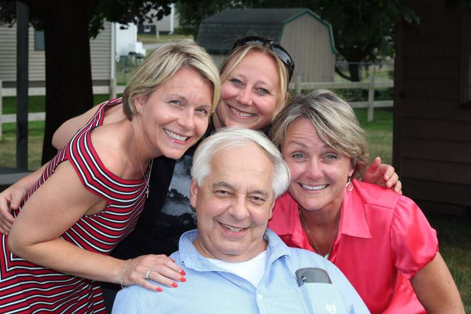 Paul Kubacki (front) is the owner of Herbert Funeral Home. Also pictured (from left) are Kubacki's daughters Angela Cochrane and Jen Kubacki, and his wife, Julie Kubacki. Photo: Courtesy Photo