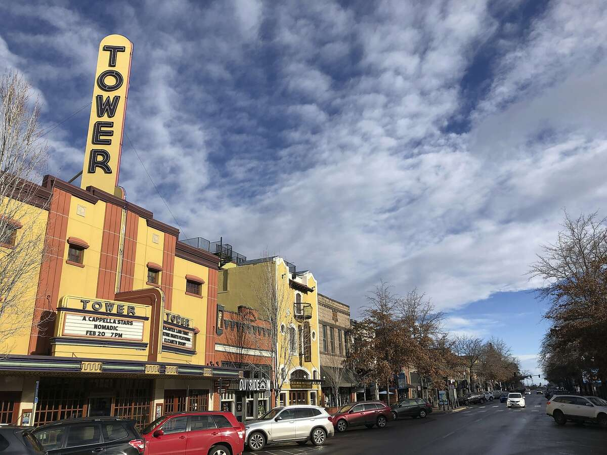 This Jan. 28, 2020 photo shows the Tower theatre located in downtown Bend, Ore., where the population in the early 1990's was around 25,000 and leaned Republican. Demographic shifts are helping push the Republican Party into a nosedive along the West Coast. The last Republican presidential candidate that California went for was George H.W. Bush. For Oregon and Washington, it was Ronald Reagan. Now, Republicans in the three states are even struggling to hold seats in Congress, statehouses and city councils. (AP Photo/Andrew Selsky)
