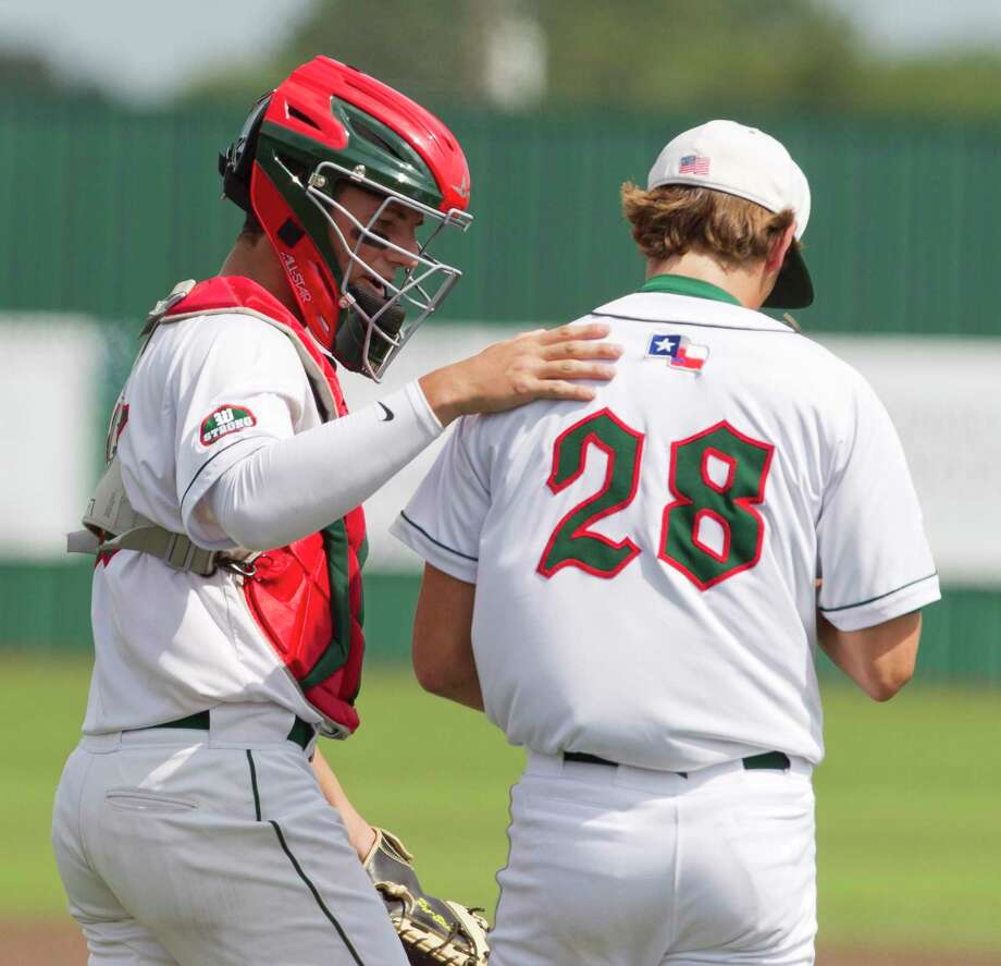 The Woodlands catcher Drew Romo (23) encourages relief pitcher Matthew Bulovas after missing a toss from first baseman Will Swope for an error in the fifth inning during a Game 3 of a Region II-6A semifinal high school baseball series at Corsicana High School, Saturday, May 25, 2019, in Corsicana. Photo: Jason Fochtman, Houston Chronicle / Staff Photographer / © 2019 Houston Chronicle