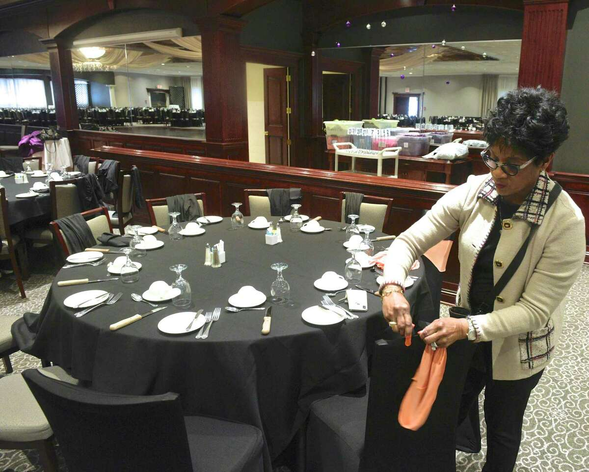 Shauna Baker, decorations chairwoman, readies a table for the Hord Foundation Wednesday as it prepares for its 27th annual gala Saturday at the Amber Room Colonnade in Danbury.