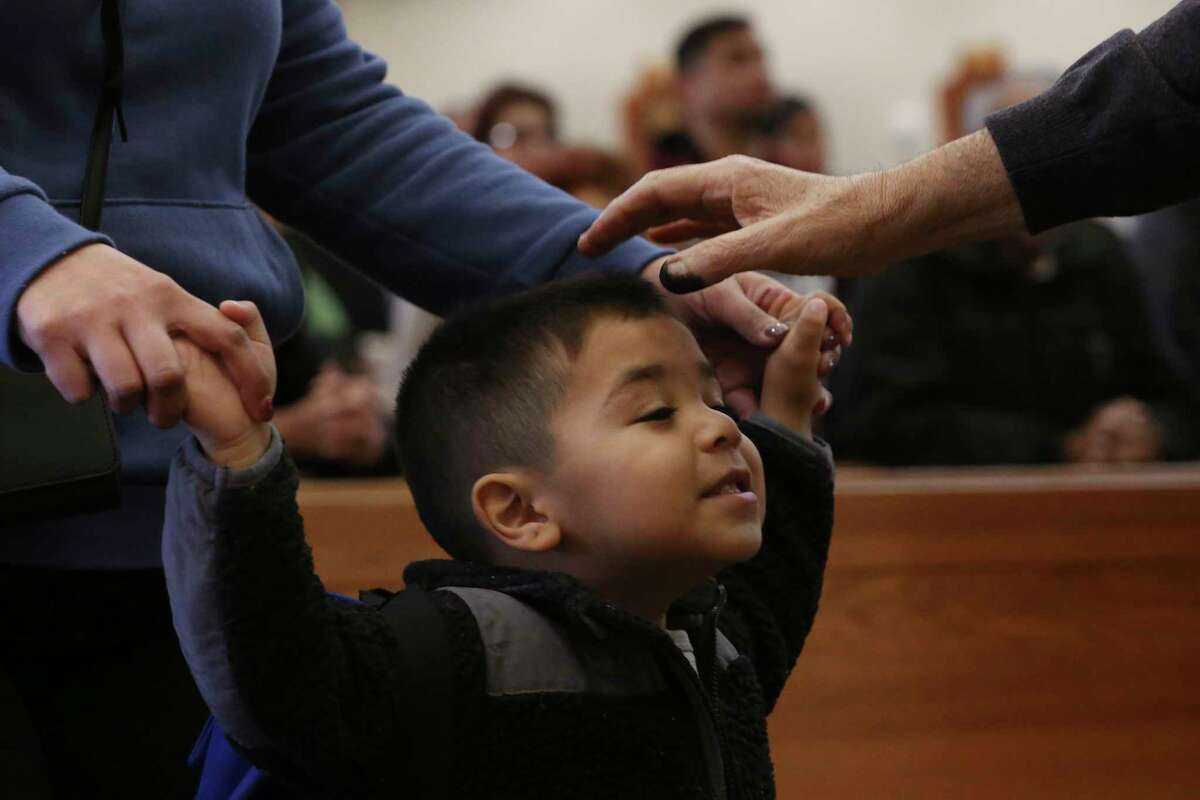 Francisco Rodriguez, 3, receives ashes on Feb. 26last year at St. Rose of Lima Catholic Church in San Antonio. This year, Catholic parishes will modify the Ash Wednesday ritual to promote social distance and reduce crowds.