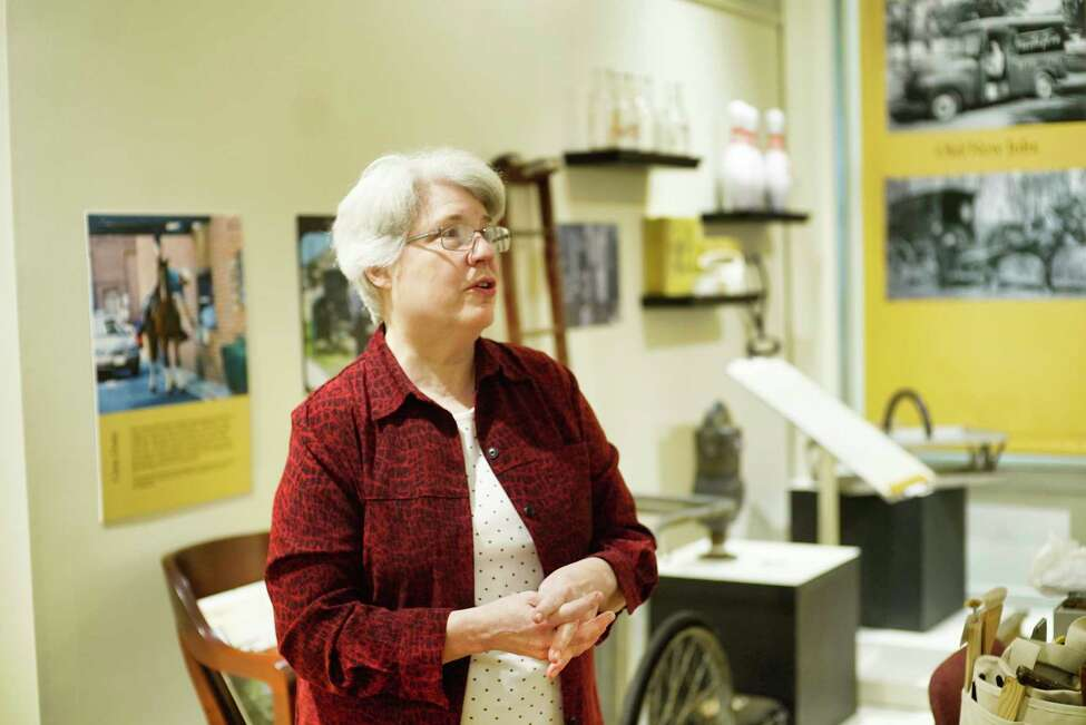 Stacy Pomeroy Draper, curator and archivist at the Hart Cluett Museum, talks about the exhibit, The Way We Work(ed), during an interview on Wednesday, Feb. 26, 2020, in Troy, N.Y. The Hart Cluett Museum is one of 10 small museums across the country participating in a new program with the Smithsonian Institute using pieces from the local collections to localize a national exhibit. (Paul Buckowski/Times Union)