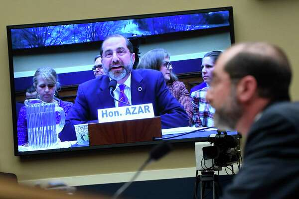 Health and Human Services Secretary Alex Azar is seen an a video screen as he testifies before a House Commerce subcommittee on Capitol Hill in Washington, Wednesday, Feb. 26, 2020, during a hearing on the budget and the coronavirus threat. (AP Photo/Susan Walsh)