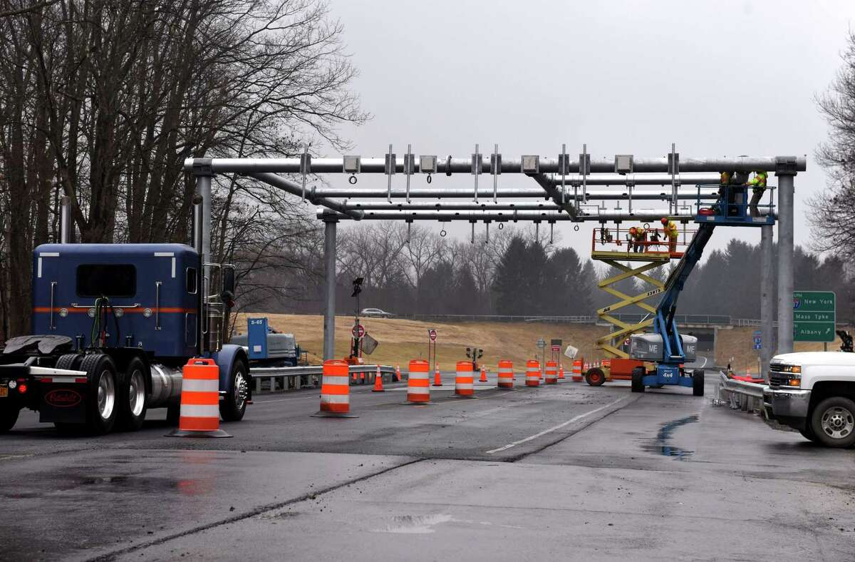 Workers construct a gantry for the new cashless tolling system being installed throughout the New York Thruway system on Wednesday, Feb. 26, 2020, at Exit 22 in Selkirk, N.Y. Installation of the gantries will continue through 2020. Toll plazas will be removed next year. (Will Waldron/Times Union)