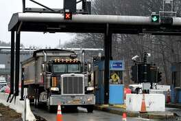 Vehicles head through the toll plaza at Exit 22 of the New York Thruway on Wednesday, Feb. 26, 2020, in Selkirk, N.Y. A cashless tolling system is being installed throughout the state Thruway system. Tollbooths will be removed next year. (Will Waldron/Times Union)