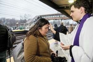 Derek Stefanovsky, Assistant Rector at St. Luke's Church, offers 'Ashes to Go' to commuters at Noroton's train station on Ash Wednesday, Feb. 26, 2020.