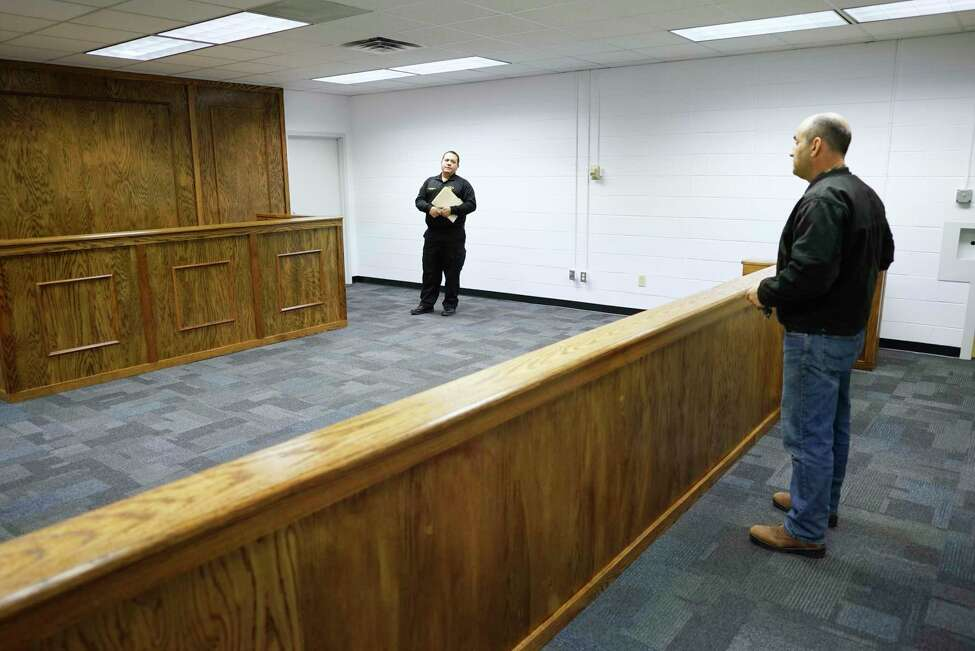 Ron Walsh, left, the superintendent of the Schenectady County Sheriff's office, and Schenectady County Sheriff Dominic Dagostino, right, are seen inside the new courtroom at the jail facility on Wednesday, Feb. 26, 2020, in Schenectady, N.Y. (Paul Buckowski/Times Union)