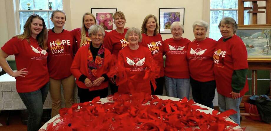 Spectrum/ Julia's Wings Foundation in Sherman is gearing up for its Operation Wear Red Campaign, held in conjunction with the National Organization for Rare Diseases' Rare Disease Day on Feb. 28, 2019, will be held March 3-10. Residents will be seeing red bows, lights, shirts, decorations and more in the area March 3-10 to raise awareness of aplastic anemia, a rare bone marrow failure disease that affects just one in 250,000 people each year. Above, volunteers gather at Sherman Senior Center to make red bows to distribute in the coming days. Courtesy of Julia's Wings Photo: Contributed Photo / Contributed Photo / The News-Times Contributed
