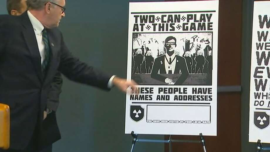 Examples of Nazi-style posters were displayed and the arrests were announced at a news conference by U.S. Attorney Brian Moran. Photo: KOMO News Photo