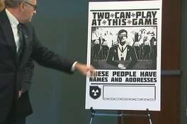 Examples of Nazi-style posters were displayed and the arrests were announced at a news conference by U.S. Attorney Brian Moran.