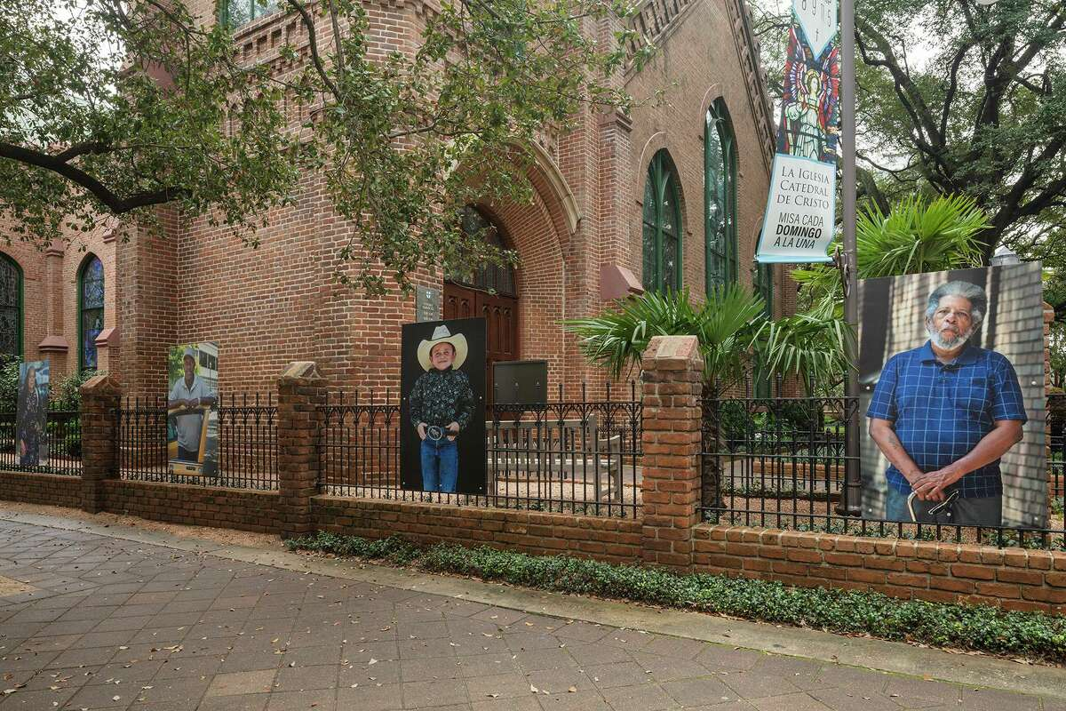 3 X 5 Portraits Lined Along Christ Church Cathedral's Fence