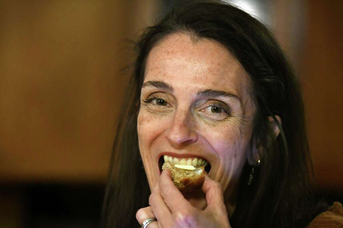 Caroline Barrett takes a bite from one of her spice cake apple muffins on Wednesday, Feb.19, 2020, at her home in Delmar, N.Y. (Will Waldron/Times Union)