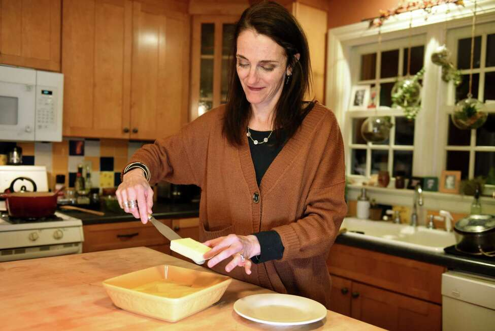 Caroline Barrett serves polenta squares on Wednesday, Feb.19, 2020, at her home in Delmar, N.Y. (Will Waldron/Times Union)