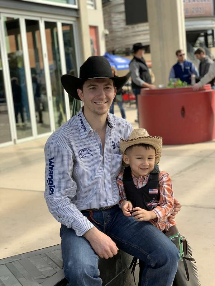 Rylin Castaneda, whose adorable toy bull-riding skills went viral in December, got a chance to experience rodeo action in real life and meet a bull rider at the San Antonio Stock Show and Rodeo. Photo: Courtesy, San Antonio Stock Show And Rodeo