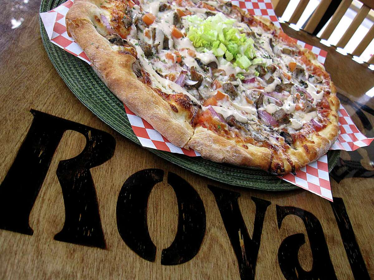 The Royal specialty pizza incorporates kebab meat, onions, tomatoes, mushrooms, lettuce and kebab sauce at Royal Pizza.