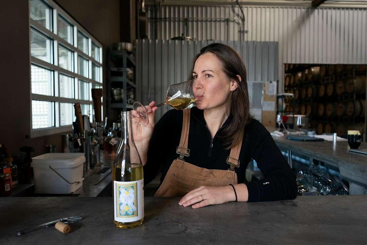Martha Stoumen sips a glass of her wine where she works in Sebastopol, California.
