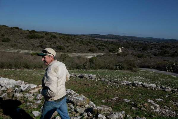 Bill Cofer walks outside the Frio Bat Cave on the Annandale Ranch in Sabinal. The San Antonio Water System bought a conservation easement on the ranch to protect the Edwards Aquifer, the city's largest water source.