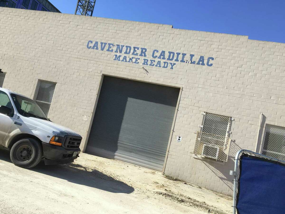 A garage at 203 8th Street that served the Cavender Cadillac dealership on Broadway, might have a future as a food hall, according to documents filed with the state. The project is named the Make Ready Dining Hall, and it is located behind the Soto (in the background), a six-story complex undergoing construction.