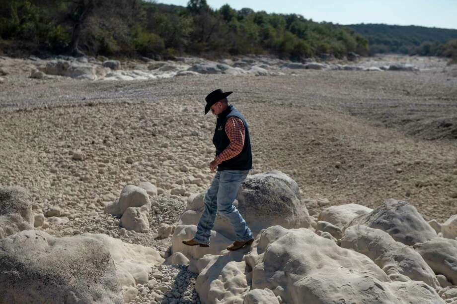 Dripstone Ranch supervisor Farron Sultemeier walks along the dry riverbed of the Frio River at the ranch between Concan and Sabinal. The river has disappeared here as it drops straight into the Edwards Aquifer Recharge Zone. Photo: Josie Norris, Staff Photographer / **MANDATORY CREDIT FOR PHOTOG AND SAN ANTONIO EXPRESS-NEWS/NO SALES/MAGS OUT/TV