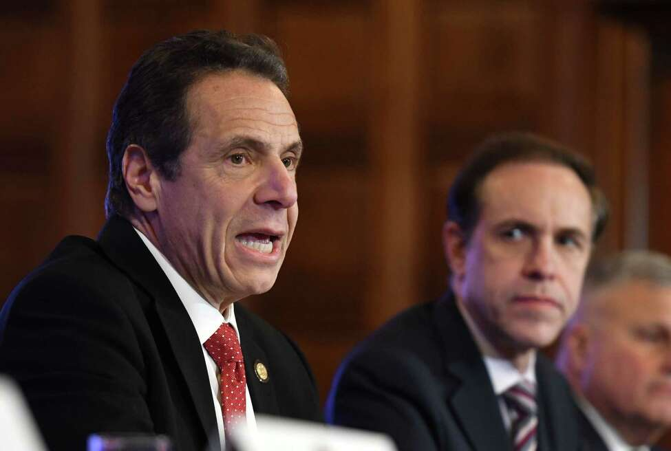 Gov. Andrew Cuomo is joined by State Department of Health Commissioner Dr. Howard Zucker, right, and other state officials, during a media briefing on state plans to handle a potential coronavirus outbreak on Wednesday, Feb. 26, 2020, at the Capitol in Albany, N.Y. (Will Waldron/Times Union)