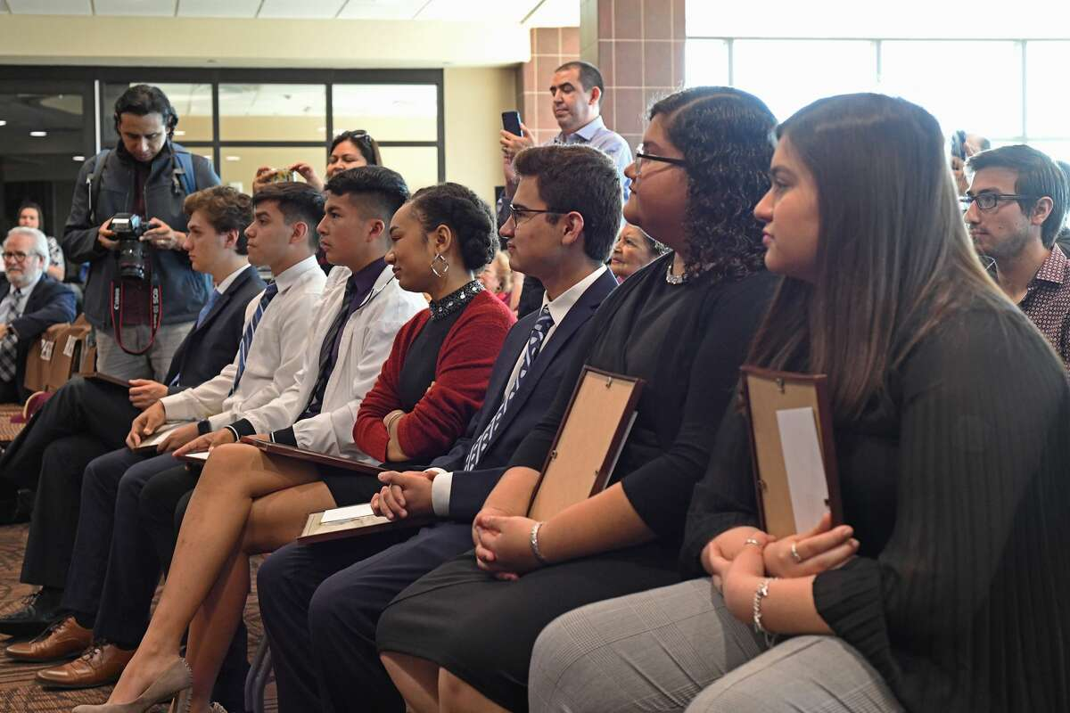 Recipients of the Mr. South Texas scholarship wait for a group photo after receiving their scholarship and recognition at the Zaffirini Student Success Center Tuesday.