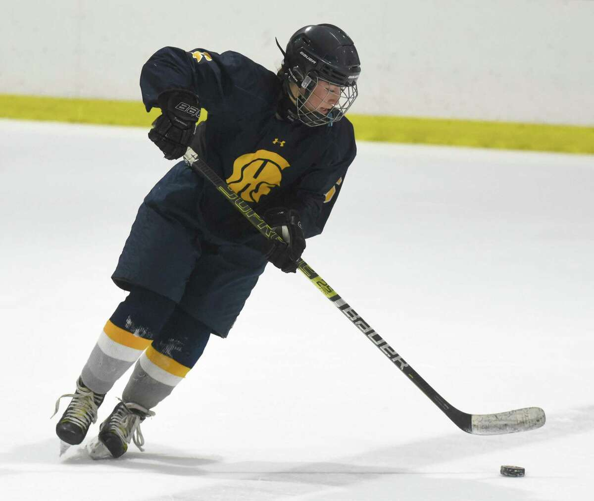 Simsbury's Anna Melanson (6) controls the puck during a girls ice hockey game against New Canaan at the Darien Ice House on Dec. 10, 2019.