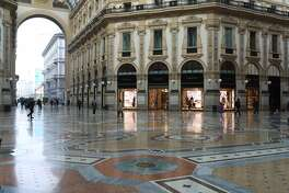 MILAN, ITALY - FEBRUARY 26: The Vittorio Emanuele Gallery in the city center is seen empty on February 26, 2020 in Milan, Italy. The country is struggling to understand how it went from six coronavirus cases to 374 cases and 12 dead since last Friday, becoming Europe's worst-affected country. Many communities across the Lombardy and Veneto regions have seen the suspension of public events and church services, and the closure of grade schools, universities and museums. Twelve towns have been locked down entirely, with road blocks preventing the exit and entrance of people. The government has also imposed quarantines for those who have had close contact with confirmed cases of the illness. (Photo by Marco Di Lauro/Getty Images)