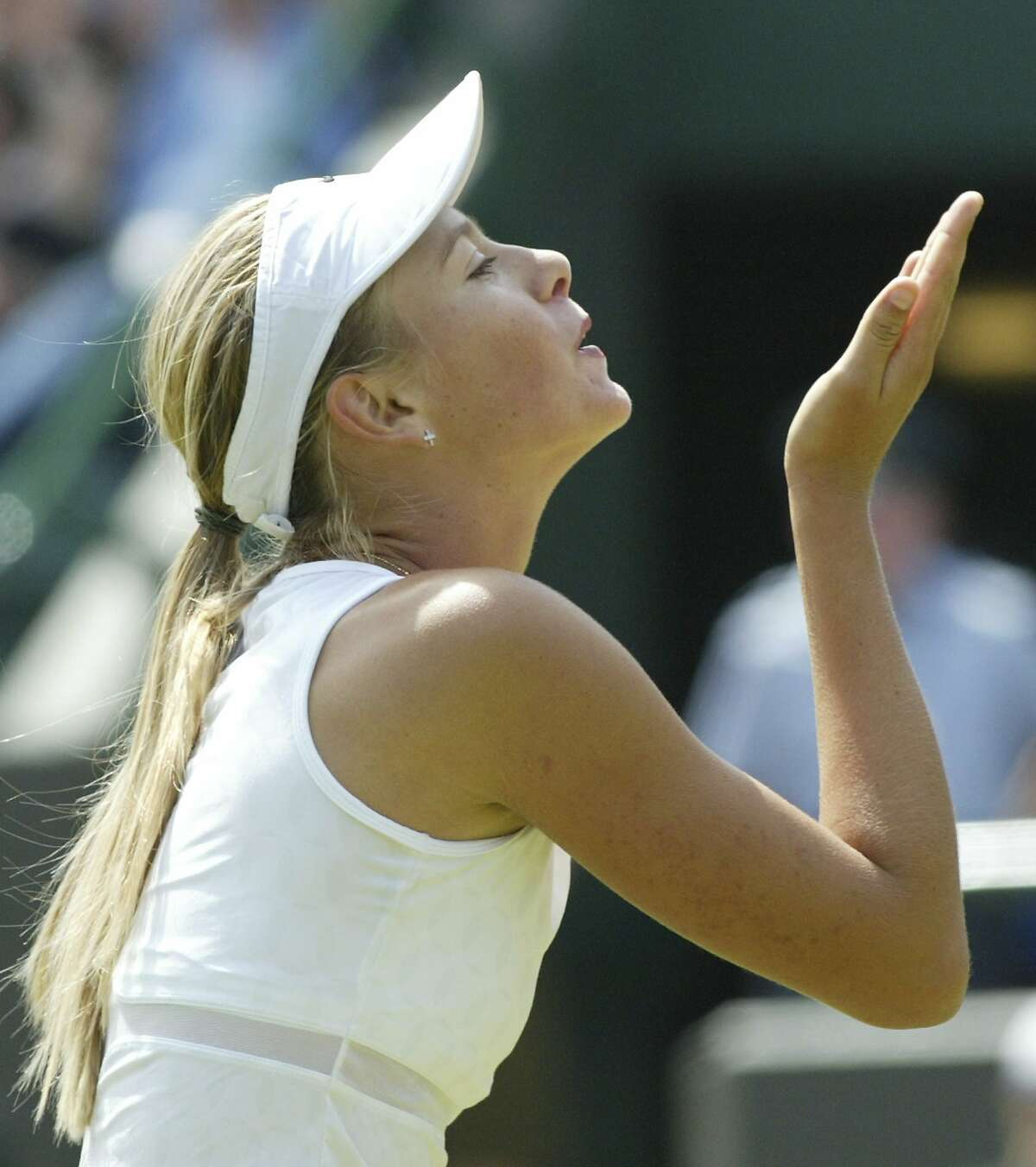 FILE - In this June 28, 2003, file photo, Russia's Maria Sharapova blows a kiss to the crowd after deafeating Yugoslavia's Jelena Dokic, in their Women's Singles third round match at Wimbledon. Sharapova walked away from her sport rather quietly Wednesday, Feb. 26, 2020, at the age of 32, ending a career that featured five major championships, time at No. 1 in the WTA rankings, a 15-month doping ban and plenty of problems with her right shoulder.(AP Photo/Dave Caulkin, File)