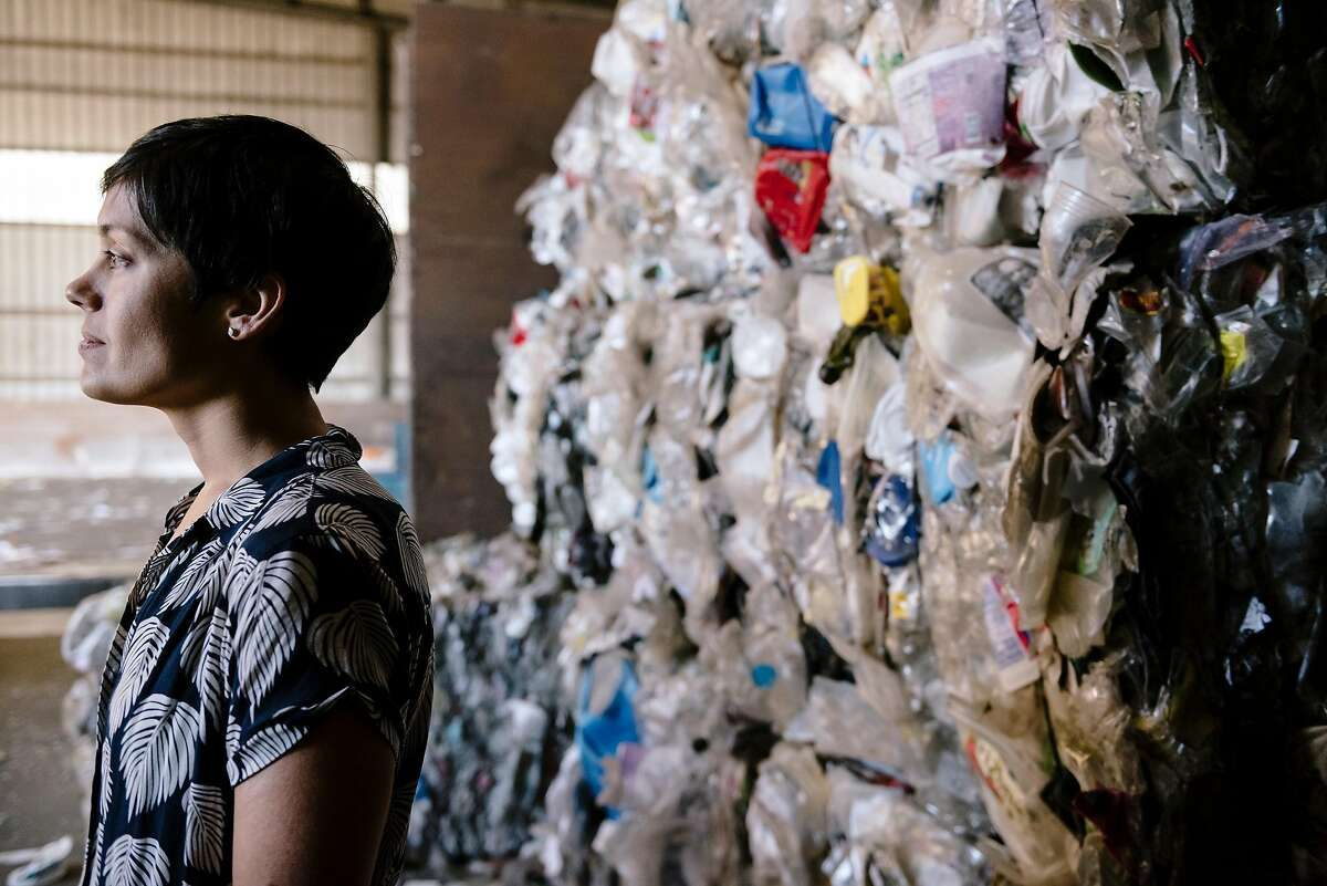 Earth Island Institute's general council Sumona Majumdar stands for a portrait in front of bails of plastics at the Berkeley Recycling Center in Berkeley, California, on Tuesday, Feb. 25, 2020. Earth Island Institute will file a lawsuit at noon Wednesday accusing some of the biggest beverage and product manufacturers in the United States, including Coca-Cola, Pepsi, Nestle, Danone, Colgate, Procter & Gamble, Mars, Crystal Geyser, and Mondelez, among others, of polluting the ocean, waterways and San Francisco Bay with millions of tons of plastic.