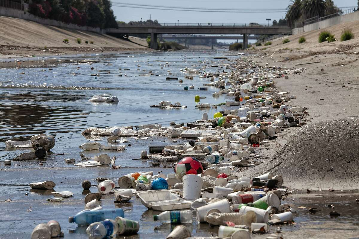 Large amounts of trash and plastic refuse collect in Ballona Creek after first major rain storm, Culver City, California, USA.