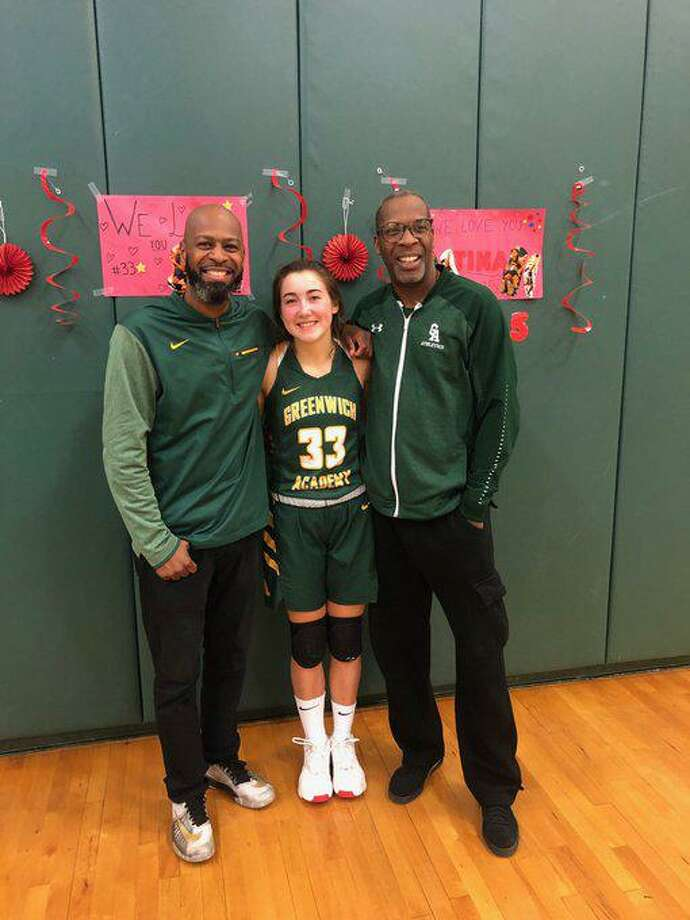 Greenwich Academy senior Francesca Sileo scored her 1,000th career point for the school's basketball team recently, in her final game. Pictured with her is GA assistant coach Wilner Joseph, left, and coach Wes Matthews. Photo: Contributed Photo