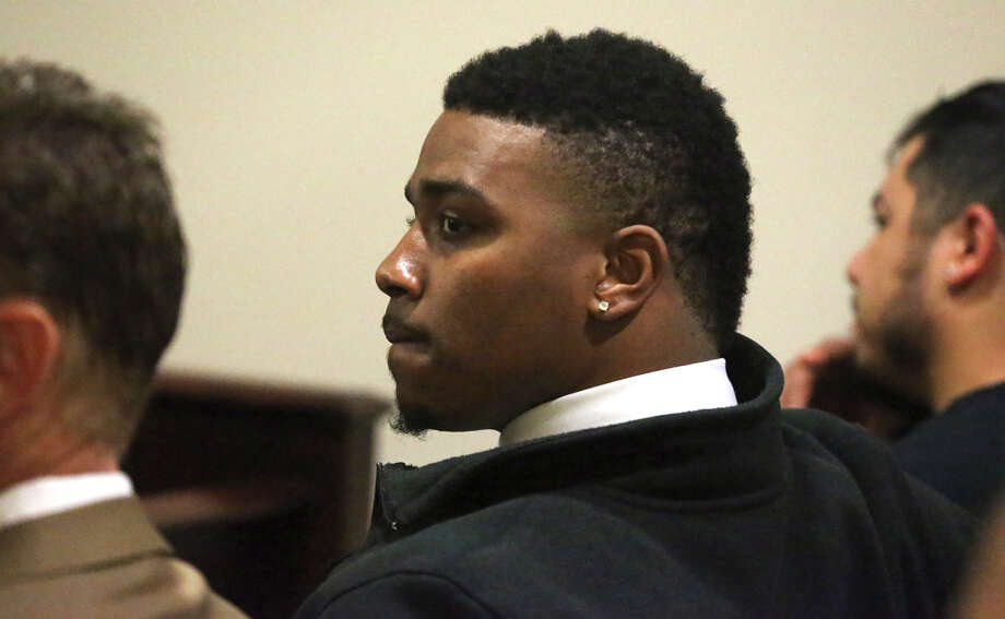Former Texas Christian University quarterback Trevone Boykin (center) sits in court in San Antonio Wednesday March 23, 2016. Boykin was charged with assaulting a police officer in San Antonio while the team was here earlier to play in the Alamobowl. Photo: John Davenport, San Antonio Express-News / ©San Antonio Express-News/John Davenport