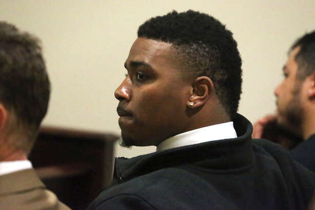 Former Texas Christian University quarterback Trevone Boykin (center) sits in court in San Antonio Wednesday March 23, 2016. Boykin was charged with assaulting a police officer in San Antonio while the team was here earlier to play in the Alamobowl.