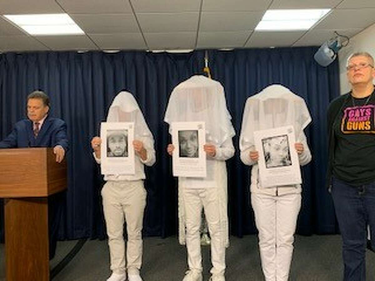 Activists with Gays Against Guns stand in white honoring victims of gun violence during a news conference with Assemblyman Felix Ortiz, D-Kings County, on Wednesday, Feb. 26, 2020. (Amanda Fries / Times Union)