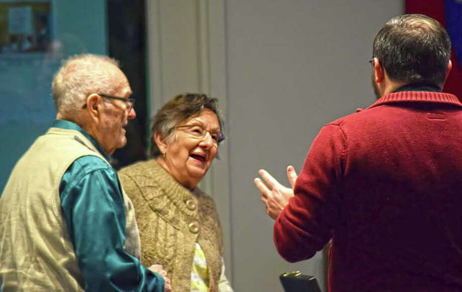 Jeannene Goodman, center, begins to laugh as she enjoys a conversation with her husband Earl, left, and newly appointed Father of St. Andrew's Episcopal Church, Ben Hankinson, during a Shrove Tuesday pancake dinner in Edwardsville. Jeannene and Earl have been Edwardsville residents and members of St. Andrew's for 60 years. Photo: Tyler Pletsch | The Intelligencer