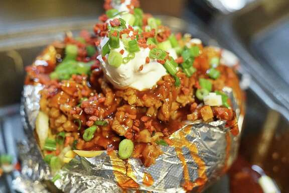 A loaded baked baked potato at the Houston Sauce Pit is 100% vegan.