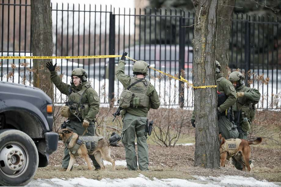 Police respond to a mass shooting at the Molson Coors Brewing Co. campus in Milwaukee. The gunman died of a self-inflicted gunshot wound, police said. Photo: Morry Gash / Associated Press