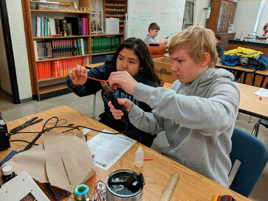 Manistee Catholic Central High School Science Olympiad team members Elena Pizana and Matthew Gunia working on Detector Building to prepare for Saturday's regional competition. (Ken Grabowski/News Advocate)