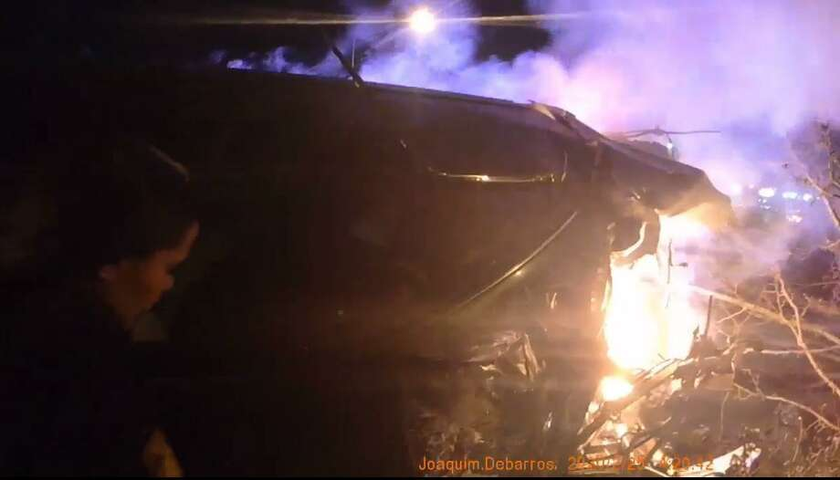 Body camera footage released of Bridgeport, Conn., police rescuing a female driver from a burning car on Chopsey Hill Road on Tuesday, Feb. 25, 2020. Photo: Contributed Photo