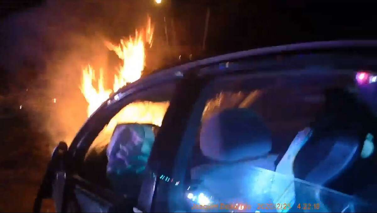 Body camera footage released of Bridgeport, Conn., police rescuing a female driver from a burning car on Chopsey Hill Road on Tuesday, Feb. 25, 2020.