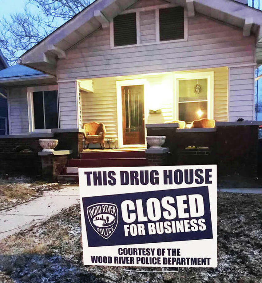 "Wood River police post a ""drug house"" sign outside of 239 E. Lorena Ave. after conducting a raid there earlier this month. Photo: Wood River Police Department"
