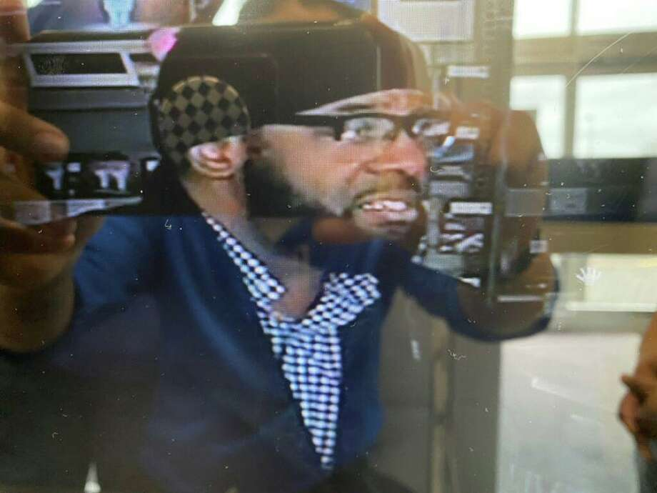 Police described him as a 6 feet 1 inch tall, weighing around 260 pounds. At the time of Wednesday theft, police said, he was wearing a blue jacket, black hat, glasses and had a beard. Photo: Contributed Photo / North Haven Police Department