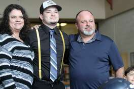 North Huron's Chris Augle poses with his family after signing his letter of intent on Wednesday morning.
