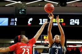 Connecticut forward Megan Walker (3) shoots over Cincinnati forward Iimar'i Thomas (23) during the first half of an NCAA college basketball game Wednesday, Feb. 26, 2020, in Cincinnati. (AP Photo/Gary Landers)