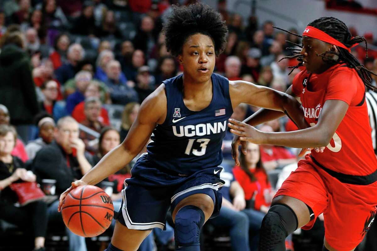 UConn guard Christyn Williams (13) drives to the basket against Cincinnati guard Florence Sifa, right, during the first half of a game Wednesday, Feb. 26, 2020, in Cincinnati.