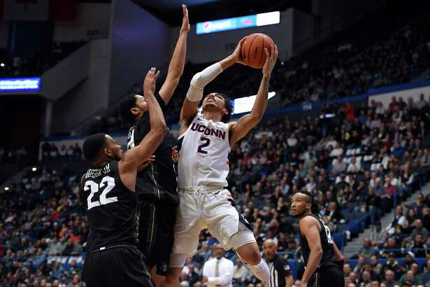 UConn's James Bouknight shoots over Central Florida's Darin Green Jr, left, and Frank Bertz, center, in the first half on Wednesday.