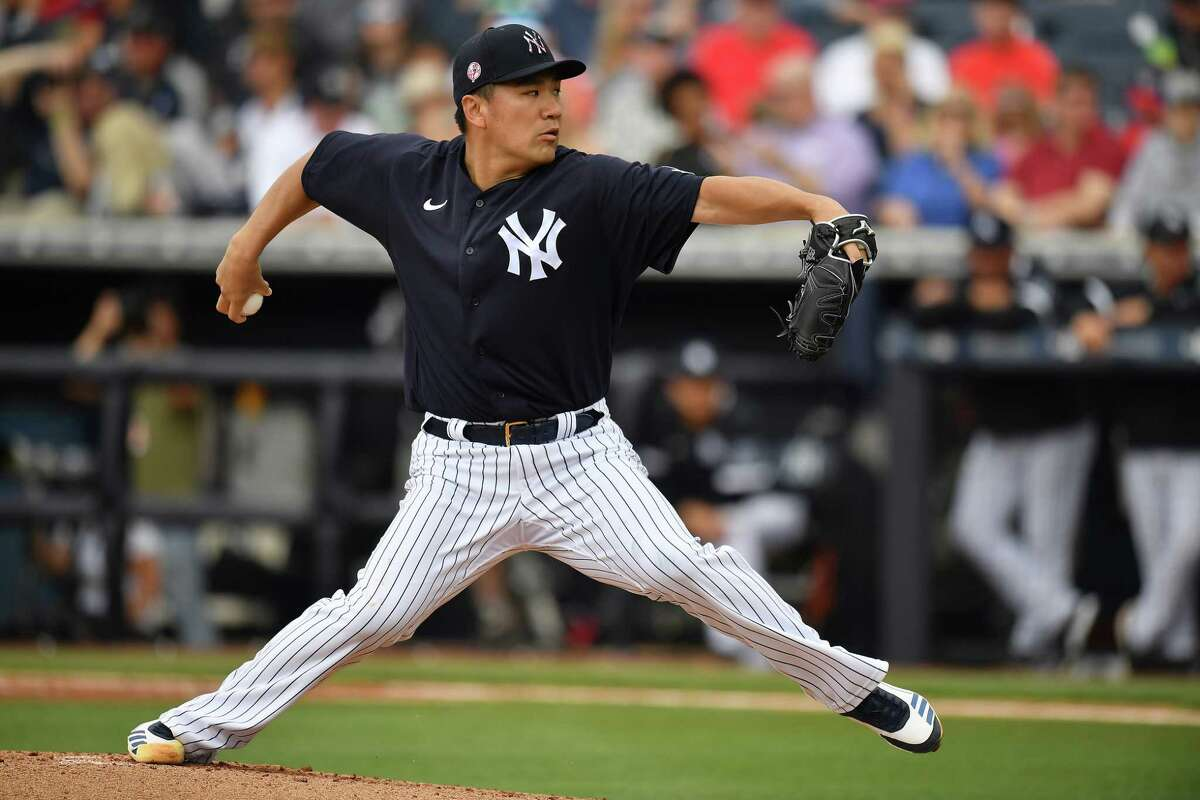TAMPA, FLORIDA - FEBRUARY 26: Masahiro Tanaka #19 of the New York Yankees delivers a pitch in the second inning during the spring training game against the Washington Nationals at Steinbrenner Field on February 26, 2020 in Tampa, Florida. (Photo by Mark Brown/Getty Images)