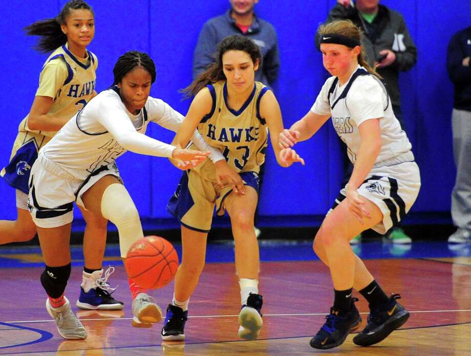 Newtown's Rebecca Alicea, center, scrambles for a loose ball with Notre Dame-Fairfield's Ciara Brown , left, and MacQuarrie Stone-Folmar during the SWC championship on Wednesday. Photo: Christian Abraham / Hearst Connecticut Media / Connecticut Post