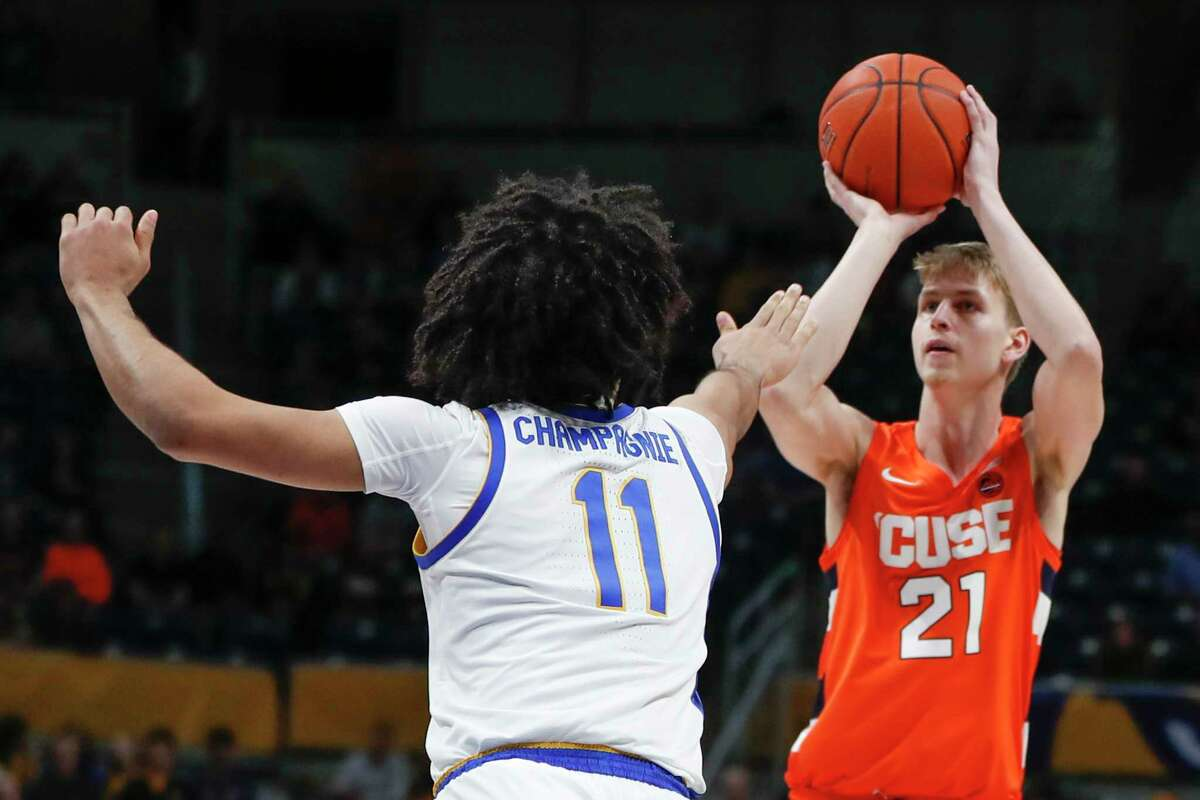 Syracuse's Marek Dolezaj (21) shoots over Pittsburgh's Justin Champagnie (11) during the first half of an NCAA college basketball game, Wednesday, Feb. 26, 2020, in Pittsburgh. (AP Photo/Keith Srakocic)